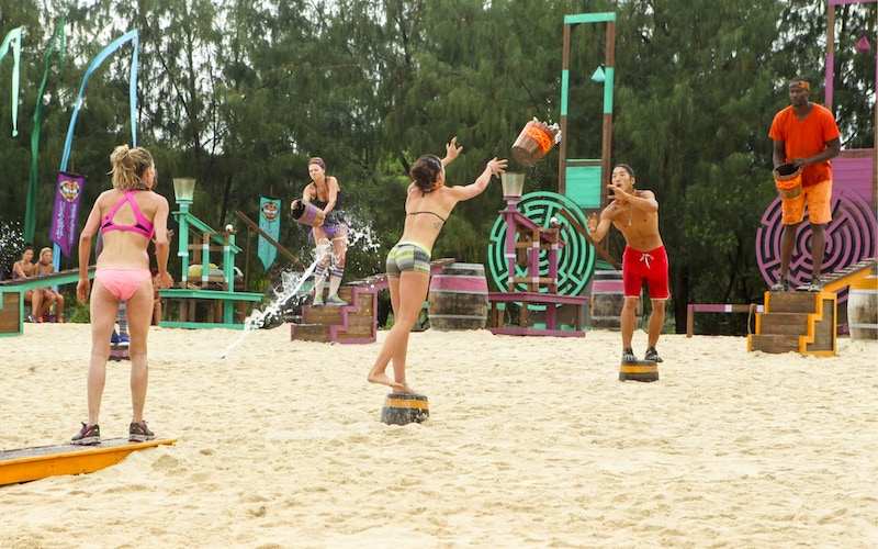 Survivor Cagayan players compete in the immunity challenge, which incorporated an element designed by a member of Survivor's Dream Team