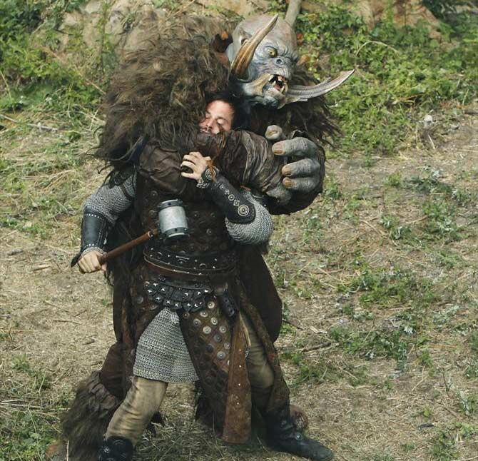 Sir Ansgar fights an ogre