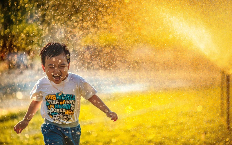 best reality shows, joy, kid running through sprinklers