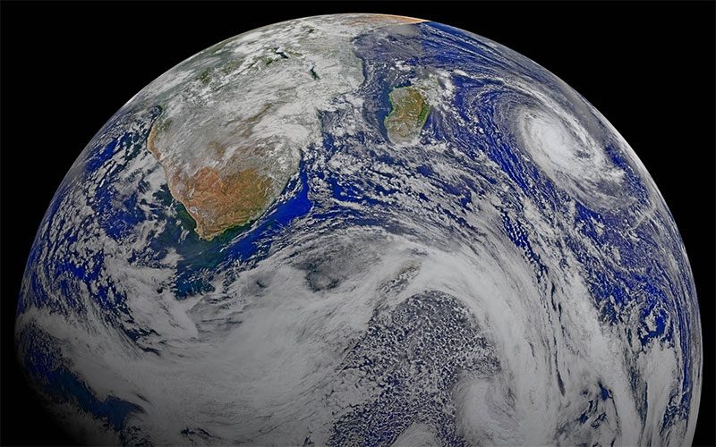 A composite view of Earth from the NASA/NOAA Suomi National Polar-orbiting Partnership spacecraft taken April 9, 2015, with Tropical Cyclone Joalane in the Indian Ocean