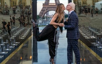 Heidi Klum and Tim Gunn kissing in front of the Eiffel Tower