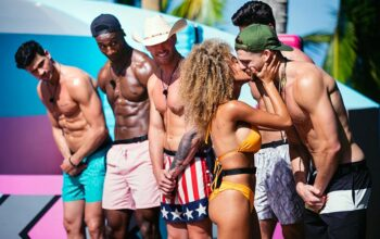 "The Love Island episode 2 challenge ""Excess Baggage,"" which appears to involve kissing"