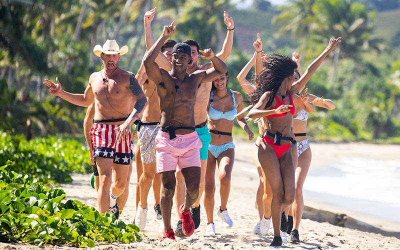 Love Island's Islanders run in slow motion on the beach