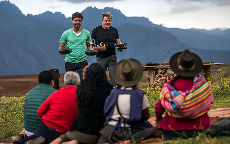 Virgilio Martinez and Gordon Ramsay serve dishes they've made to people in Peru on Gordon Ramsay: Uncharted