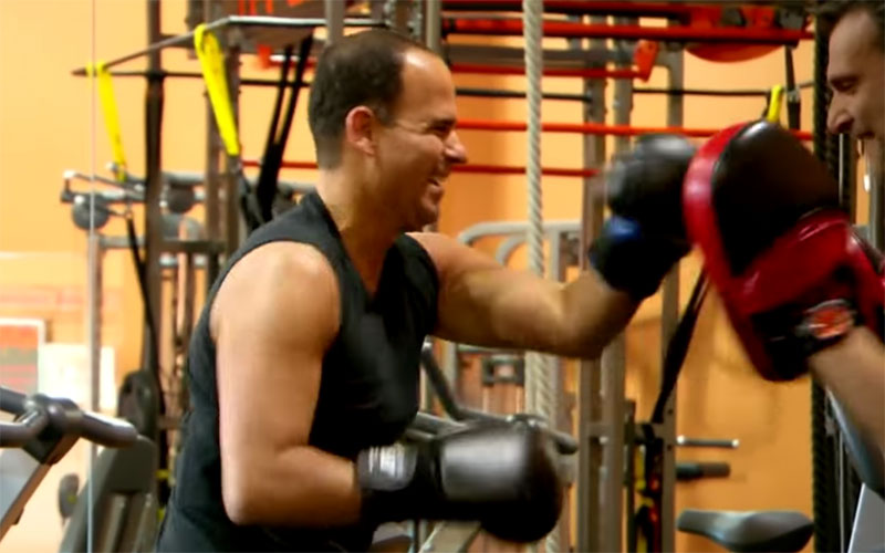 "Marcus Lemonis boxing in the ""Pro-Fit"" episode of The Profit. A CNBC executive objected to Marcus' clothing in this scene."