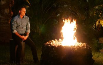 Mark L. Walberg awaits Temptation Island cast members at a season-one bonfire.