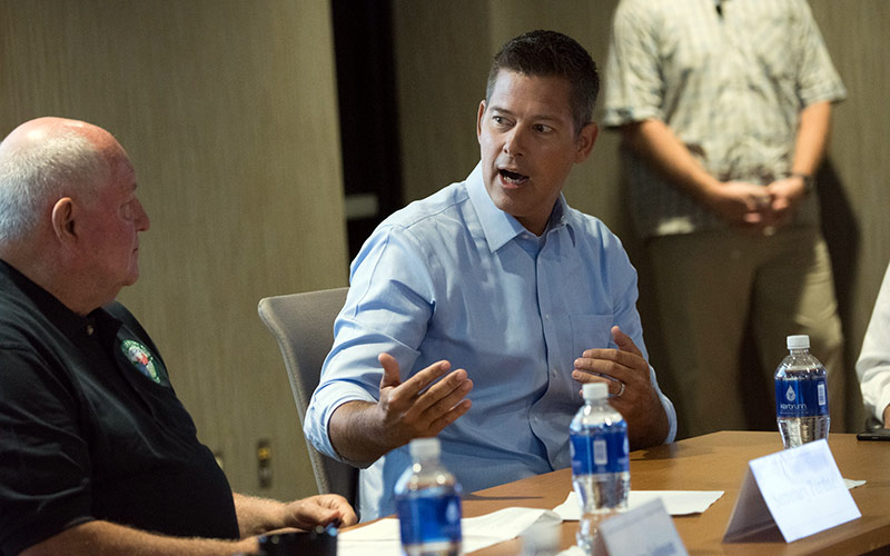 Former Real World Boston cast member and current US Representative Sean Duffy (right) talking with Agriculture Secretary Sonny Perdue in 2017 at a Rural Prosperity Task Force session