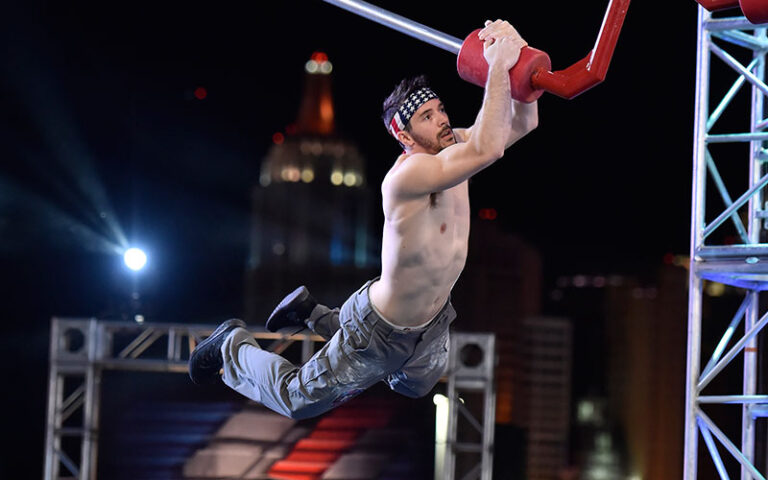 """Drew Drechsel competing on stage three of the final course during the American Ninja Warrior season 11 """"Las Vegas National Finals Night 4"""" episode, on which someone will win $1 million"""