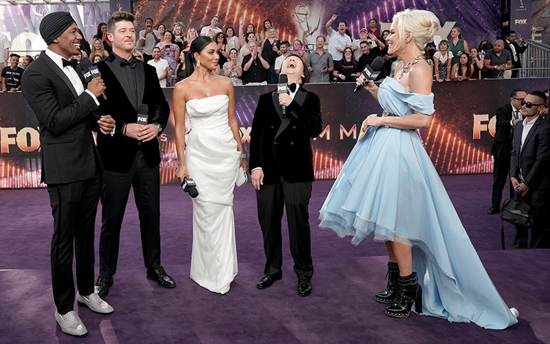 The Masked Singer judges and host on the Emmys red carpet during Fox's pre-show