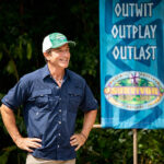 Jeff Probst on the premiere of Survivor Island of the Idols, standing next to a sign that reminds everyone what Survivor used to focus on.