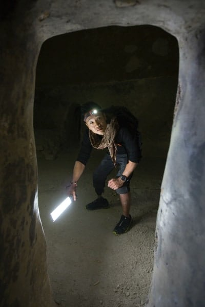 Dr. Albert Lin explores an underground crusader-era tunnel Acre, Israel