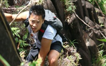 Dr. Albert Lin climbing Pwisen Malek, a volcanic mountain, on Pohnpei Island, Micronesia