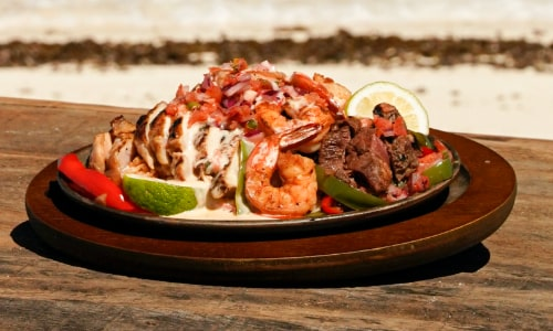 "Applebee's fajitas, a ""reward"" for the winning Survivor tribe"