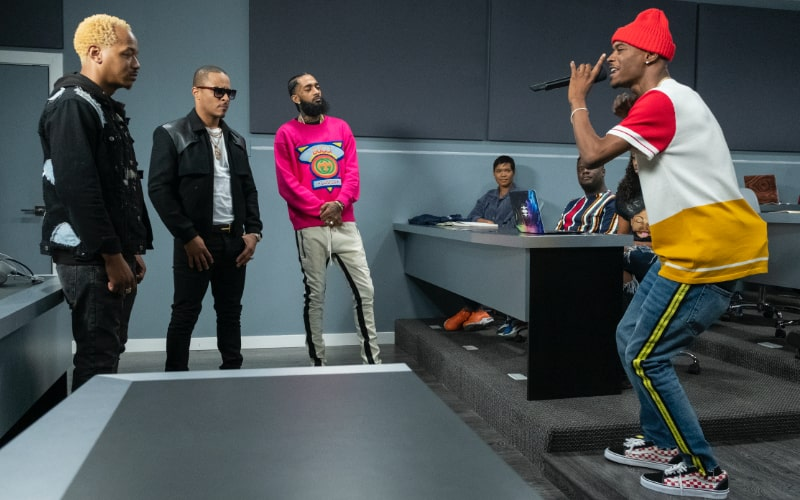 Mars, T.I., and Nipsey Hussle listen to a performance by a potential Rhythm + Flow contestant
