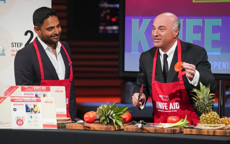 Rohan Oza and Kevin O'Leary demonstrating Knife Aid, before the sharks started metaphorically knifing each other to invest in the company.