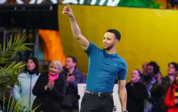 Stephen Curry on Holey Moley season 1. He'll be back as the show's golf pro—and an executive producer—for season two.