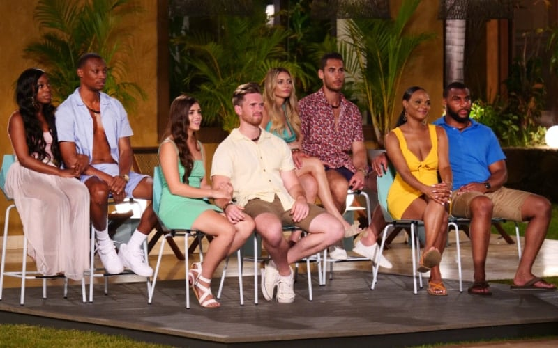 The cast of Temptation Island season 5: Ashley Godson, Rick Fleur, Ashley Howland, Casey Starchak, Kate Griffith, David Benavidez, Esonica Veira, and Gavin Rocker.