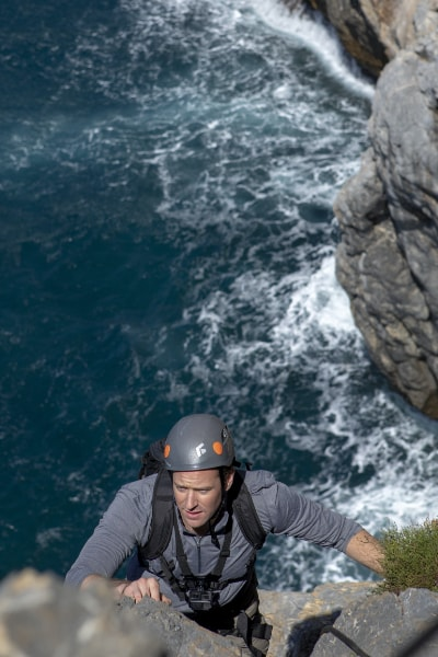 Armie Hammer climbing in Sardinia, Italy, on Running Wild with Bear Grylls season 5