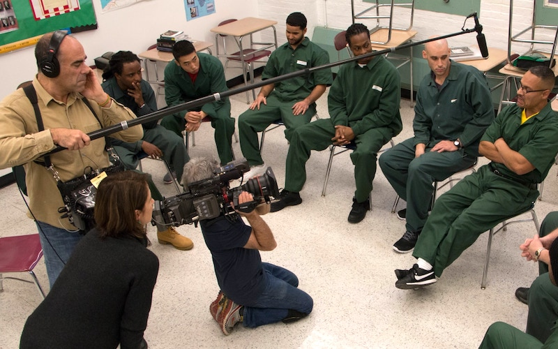 The College Behind Bars production crew interviews and films Bard Prison Initiative students