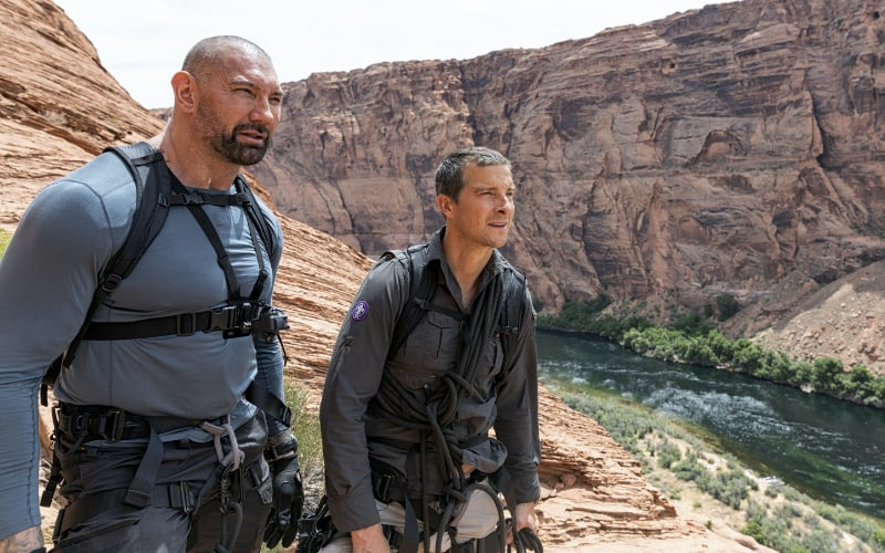 Dave Bautista and Bear Grylls in Horseshoe Bend, Ariz., looking at the Colorado River on Running Wild with Bear Grylls