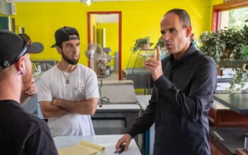 Marcus Lemonis (right) with Dante Alario (center), the owner of Dante's, on The Profit season 7's premiere.