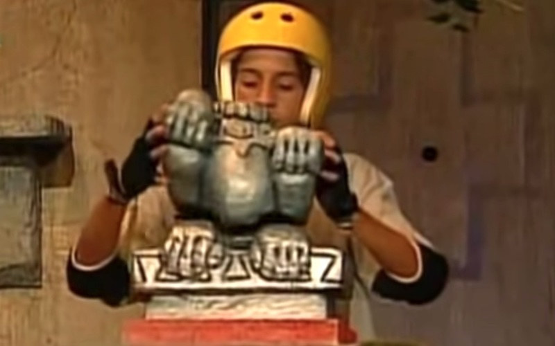 A Legends of the Hidden Temple contestant assembles the silver monkey during the Temple Run part of the show, which is returning on Quibi