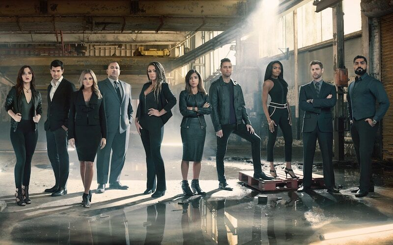 The cast of Bravo's Spy Games: Jessica Studnickey, George Jackson, Chelsea Mori, Dr. Mitch Abrams, Christina Randall, Nika Nour, Colin Hutzler, Charnel Wright, Brock Thompson, and Saif Kareem