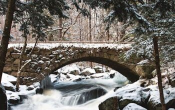 A New Hampshire bridge in winter, which will take us from fall to spring reality TV shows