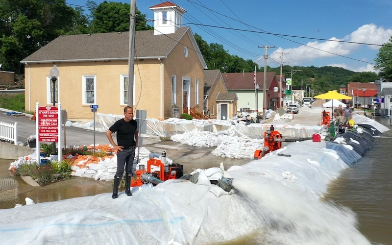 Marcus Lemonis in Grafton, Ill., which experienced flooding in the summer of 2019