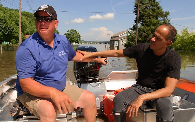 Grafton, Ill., Mayor Rick Eberlin and The Profit star Marcus Lemonis inspecting the flooded parts of the city.