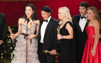 Free Solo directors Elizabeth Chai Vasarhelyi and Jimmy Chin accept the 2019 Oscar for best documentary feature. Star Alex Honnold is second from the right