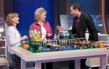 Lego Masters contestants Jessie and Kara talk to host Will Arnett while constructing their theme park