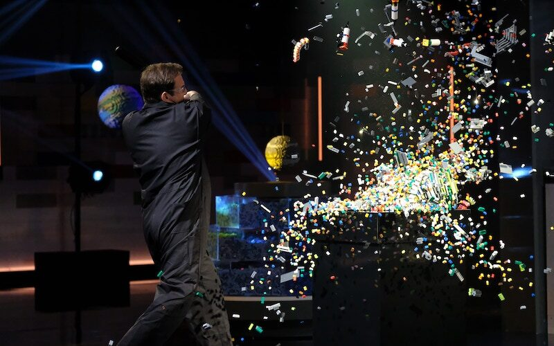"""Lego Masters host Will Arnett smashes destroys a Lego creation during episode two, """"Space Smash."""""""