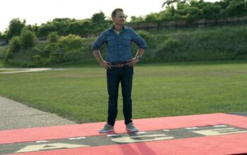 Amazing Race host Phil Keoghan waiting for the first team to arrive during the finale of The Amazing Race 31, which aired its finale about a year after production ended