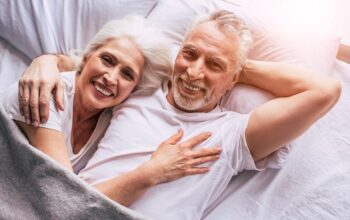 A stock photo of a senior couple in bed; not an actual couple on The Bachelor: Senior Citizen edition