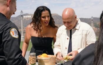 Bryan Voltaggio (foreground) cooks for Top Chef All Stars LA judges Padma Lakshmi and Tom Colicchio