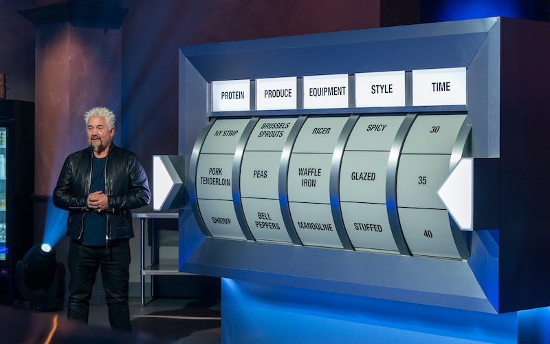 Host Guy Fieri and Tournament of Champions' randomizer, which determines what and how the chefs will cook