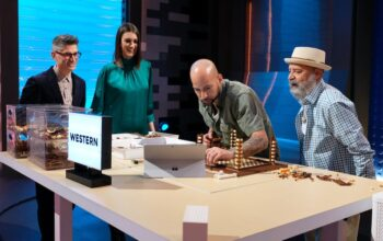 """Lego Masters judges Jamie Berard and Amy Corbett visit contestants Manny and Nestor during the early part of the """"Movie Genres"""" challenge"""
