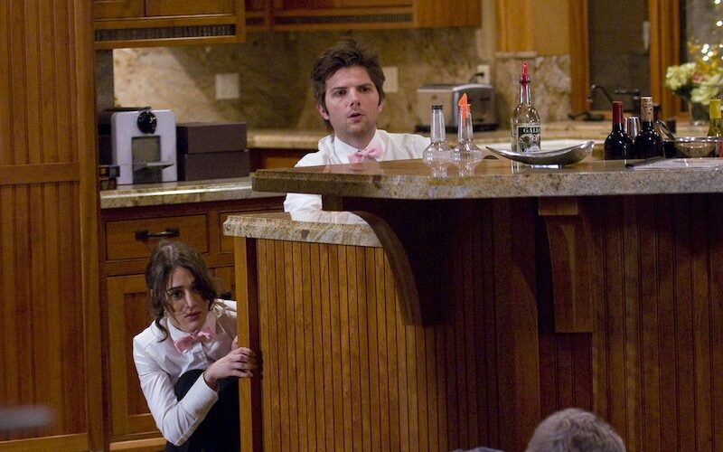 Lizzy Caplan and Adam Scott in an episode of Party Down