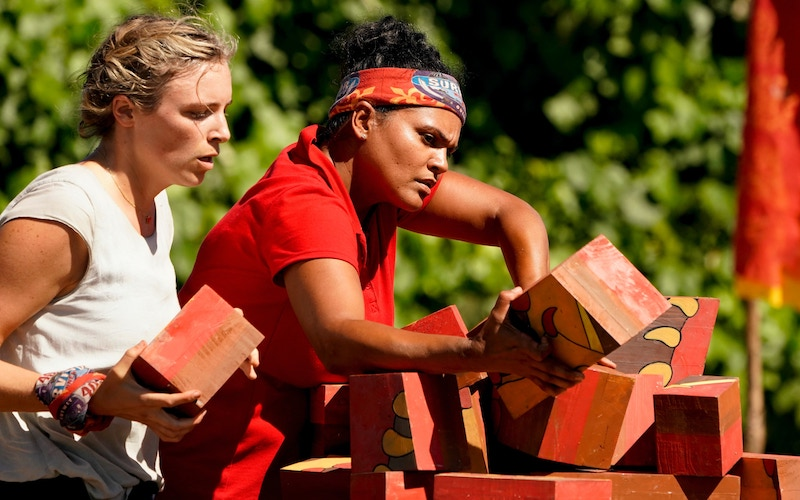 Rare footage of Sandra Diaz-Twine (right) competing in a Survivor challenge. In episode 2, she and Sophie Clarke completed the puzzle first, giving their Survivor Winners at War tribe immunity