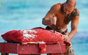 Tony Vlachos stabs open a bag of rice during the Survivor: Winners at War episode 6 immunity challenge.