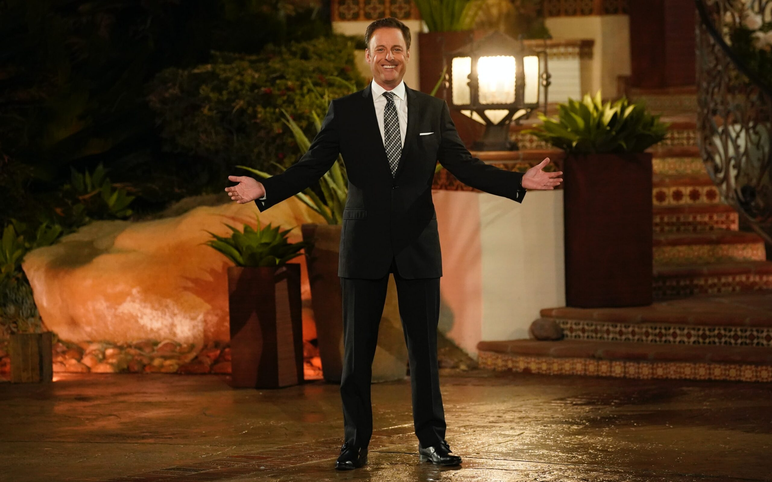 Chris Harrison on The Bachelor mansion's wet driveway, getting ready for The Bachelor: Listen to Your Heart cast members' arrivals