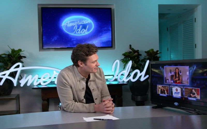 Ryan Seacrest watches American Idol's judges critique Olivia Ximines' performance on the top-20 episode.