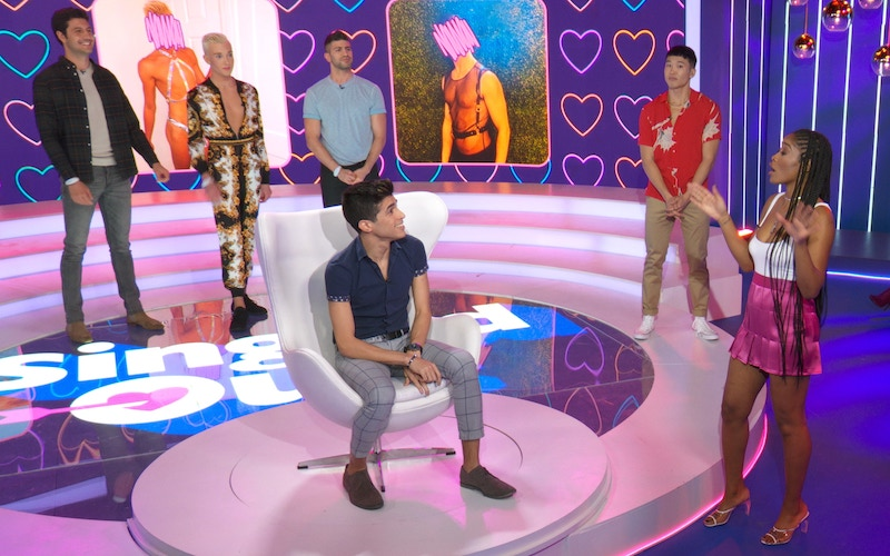 Singled Out hosts Joel Kim Booster and Keke Palmer (right) with contestants on an episode of the rebooted show