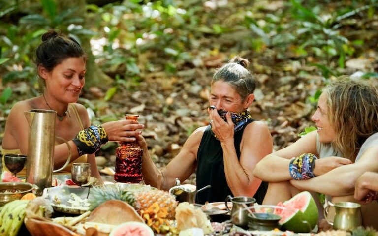 Michele Fitzgerald, Denise Stapley, and Sophie Clarke at the Survivor: Winners at War merge feast, when Denise told the story of slaying Survivor queen Sandra