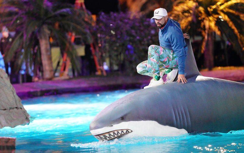 Holey Moley season 2 involves a shark, ridden here by contestant Matthew Goldberg