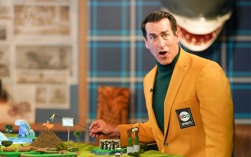 Rob Riggle shows a model of the new Holey Moley course