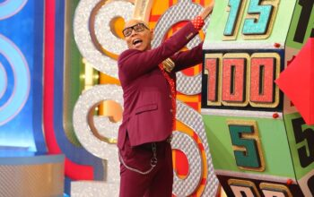 RuPaul spins the big wheel at the Showcase Showdown on The Price is Right at Night with RuPaul