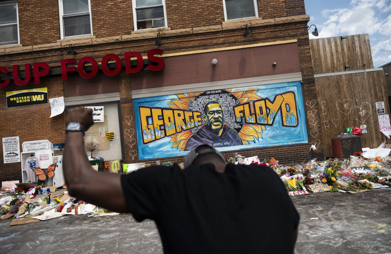 A memorial for George Floyd where he was killed, as seen in PBS' Race Matters: America in Crisis
