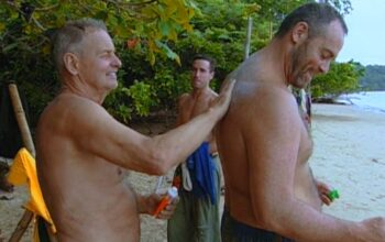 "Rudy rubs sunscreen on Richard Hatch's back during Survivor Borneo episode 2, ""The Generation Gap"""